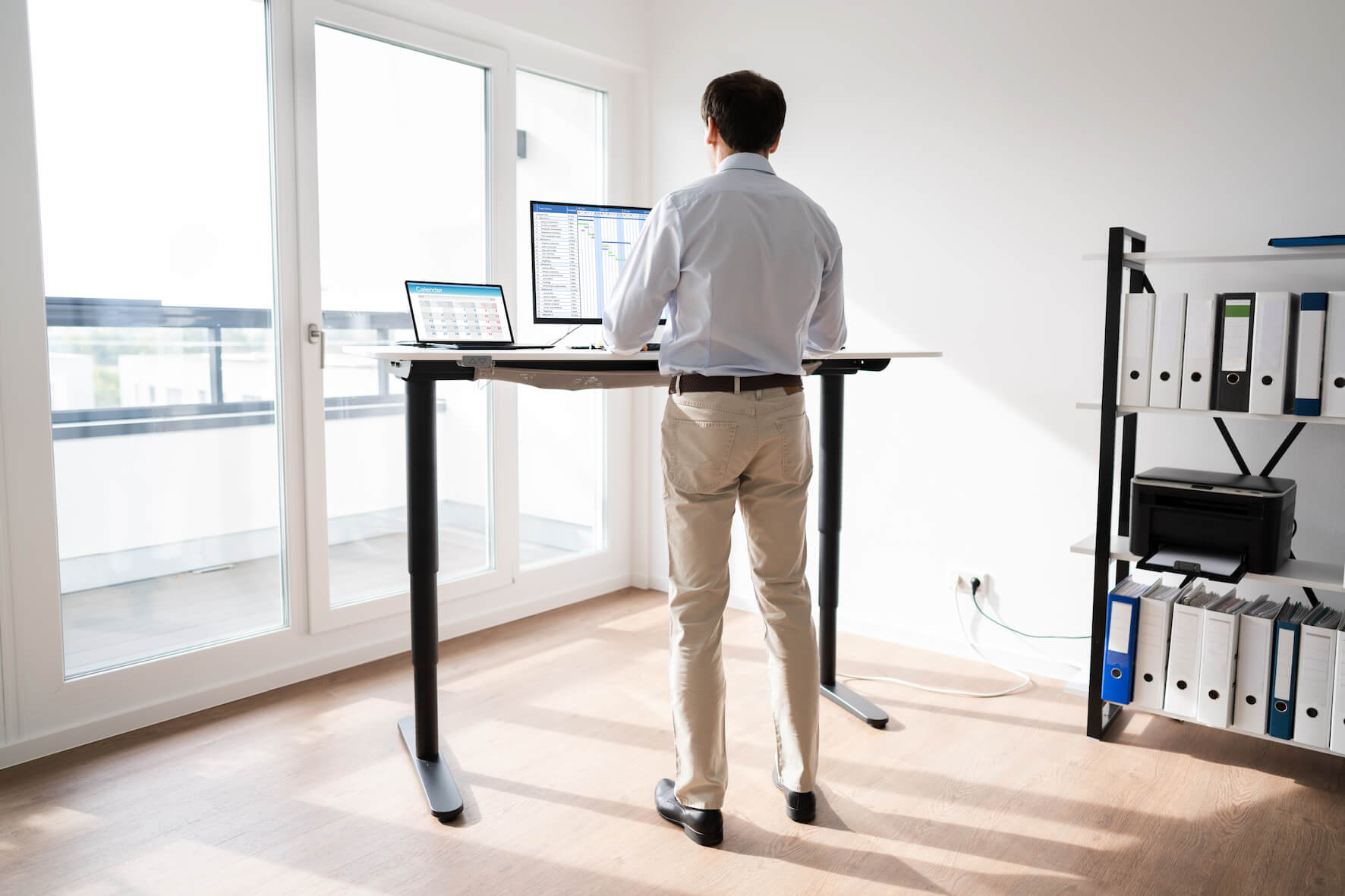 Physiotherapy advice about good posture at work using a standing desk